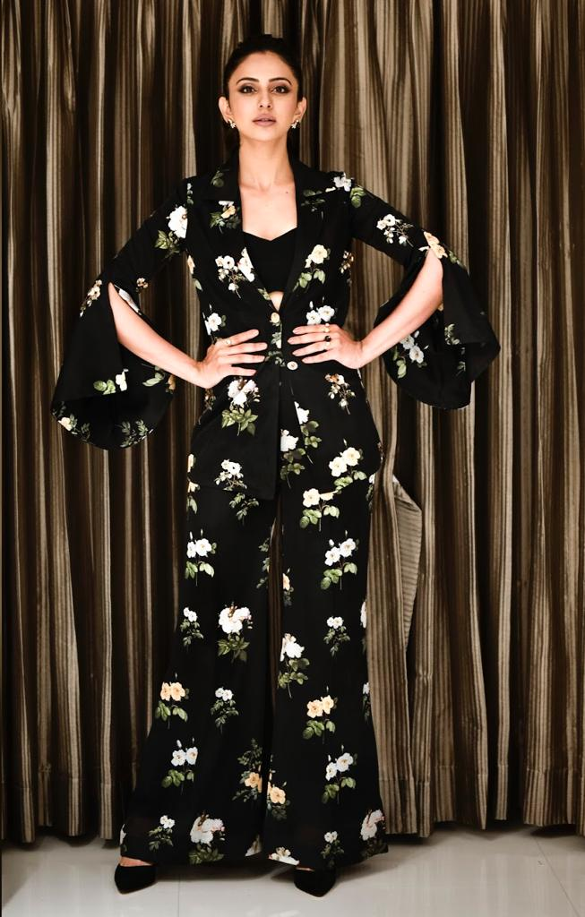 Actress Rakulpreet spotted wearing out Black floral blazer and pant set for an event.